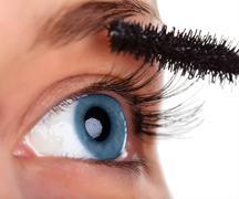 Woman eye with mascara brush Stock Photos