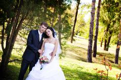 A newlywed couple in a forest Stock Photos