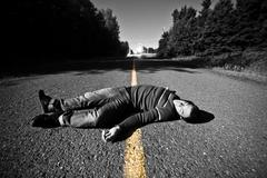 Empty road with dead body in the middle Stock Photos