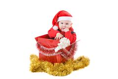 Infant with gifts in the decorated christmas box Stock Photos