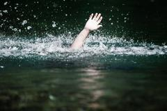 Hand of someone drowning and in need of help Stock Photos