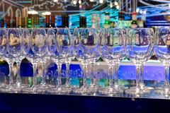 clean glasses on a bar rack - stock photo