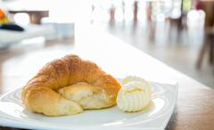 Stock Photo of croissant with butter
