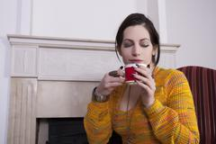 Attractive woman drinking coffee - stock photo