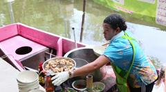 Asian Food Vendor Making Tasty Spicy Pork Soup At Floating Market Stock Footage