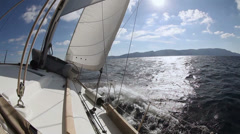 Sailing yacht on the race in blue sea Stock Footage