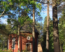 JOKKMOKK, SWEDEN : entrance Jokkmokk Old Church in mixed forest Stock Footage