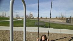 Kid swinging HD Stock Footage