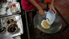 Vendor Beating Eggs and Frying an Omelette in Bangkok Stock Footage