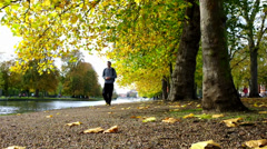 Man walking on a riverside footpath Stock Footage