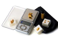 weighing of gold - stock photo