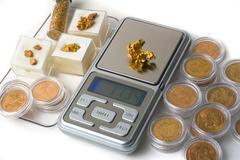 Weighing of gold Stock Photos