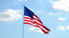 Flag blows in wind with clouds Stock Footage