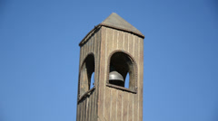 Stock Video Footage of Wooden belfry imitation with bell move on background of blue sky