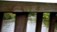 Stock Video Footage of walking a long a wooden bridge over river