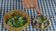 Housewife preparing healthy natural mint herb tea Stock Footage