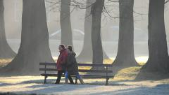 Women walking through park on a frosty morning Stock Footage