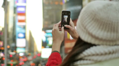 Tourist Takes Picture in Times Square - stock footage