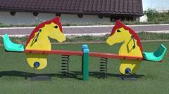 Empty toy horsey on children's playground Stock Footage