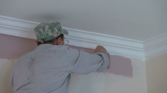 Worker painting walls, applying a new color with paint roller, home decorate Stock Footage