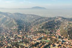 Aerial View Of Brasov City In The Carpathian Mountains - stock photo