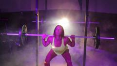 Woman Barbell Squat at Smokey Gym Stock Footage