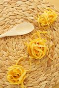 uncooked tagliatelle - stock photo