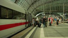 People getting on and off the modern, intercity train at Berlin main station. Stock Footage
