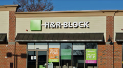 H&R Block storefront zoom-in Stock Footage