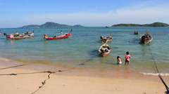 Longtail boats parked in Rawai beach in Phuket island. Thailand Stock Footage