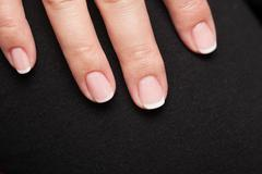 Close-up of woman hand with french manicure Stock Photos