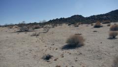 Desert Sand Jib with Brush and Rocks Southwest Desert Stock Footage