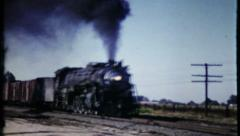 Trains bellow out thick smoke as they pass by, 615 vintage film home movie Stock Footage