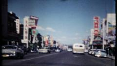 612 - generic street scene of anytown USA - vintage film home movie - stock footage