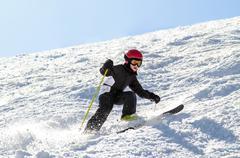 Young skier on an uneven slope Stock Photos