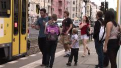 Berlin, Germany - people get in and out of a yellow tram Stock Footage