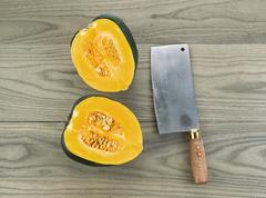 Large acorn squash cut in half Stock Photos