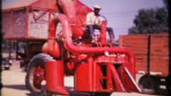 Farming equipment is used for the harvest, 614 vintage film home movie Stock Footage