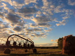 Tractor rake at sunset. Time Lapse - stock footage