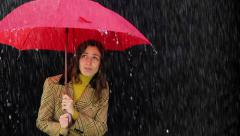 Worried Woman in the rain holding umbrella Bad weather concept Stock Footage