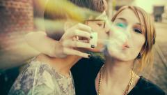 Young teenage girl and boyfriend blowing bubbles with vintage color correction Stock Footage