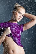 blonde woman with water droplets - stock photo