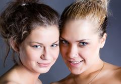 two young  blonde and  brunette woman - stock photo