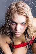 expressive woman with water droplets - stock photo
