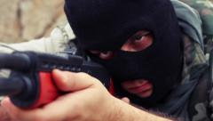 Masked Armed Man Aiming To shoot with Rifle - stock footage