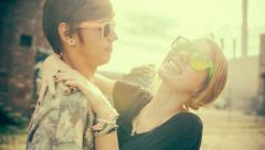 Teenage hipster boyfriend and girlfriend having fun in the sun Stock Footage