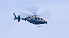 Police helicopter spying Stock Footage