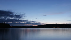 Dusk to Night over the lake. Timelapse. Stock Footage