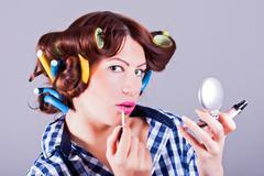 Girl applying mascara - stock photo