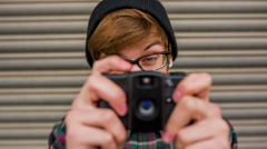 Young man taking photos with vintage camera - stock footage